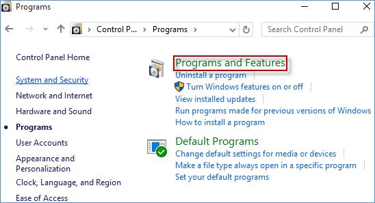Шаг 3: Затем нажмите ссылку « Программы и компоненты» .
